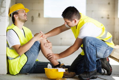 Two construction workers - one with injury